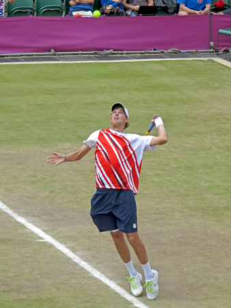 WIMBLEDON, ENGLAND - August 2nd, 2012 - Mike Bryan during one of his double matches at the summer Olympics in London in 2012. They went on to win the gold medal Editorial