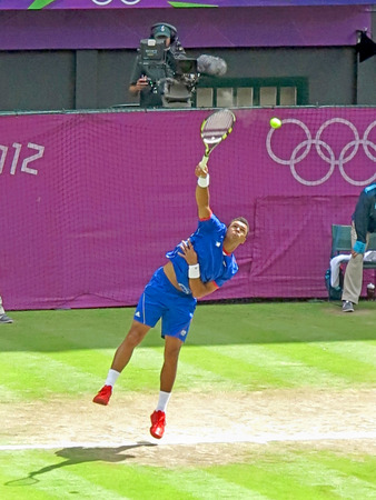 WIMBLEDON, ENGLAND - August 2nd, 2012 - Jo-Wilfried Tsonga during one of his singles matches at the summer Olympics in London in 2012. He made it to the quarterfinals in the tournament. Imagens - 46768815
