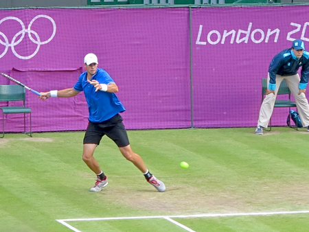 WIMBLEDON, ENGLAND - August 2nd, 2012 - John Isner during one of his singles matches at the summer Olympics in London in 2012. He made it to the quarterfinals in the tournament