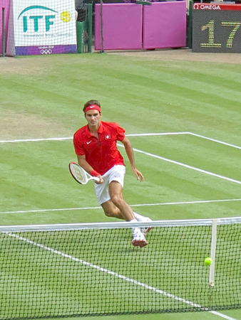 wimbledon: WIMBLEDON, ENGLAND - August 2nd, 2012 - Roger Federer during one of his singles matches at the summer Olympics in London in 2012. He came 2nd and won the silver medal in the tournament. Editorial