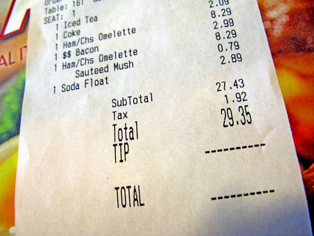 gratuity: A lunch receipt, with items and figures. Stock Photo