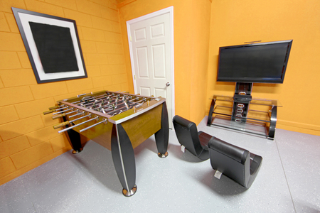 foosball: A Games Room with Foosball, TV and Gaming Chairs