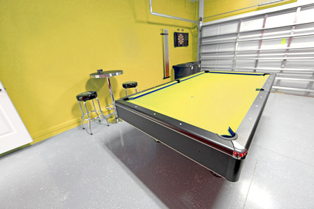 pool cues: A Games Room with Pool Table in a Garage