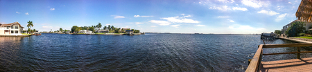 A wide river with houses and blue sky in Cape Coral, Florida Reklamní fotografie