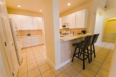 An interior photo of a kitchen in a home Imagens