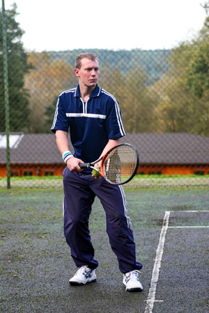 A male playing tennis on a hard court Stok Fotoğraf