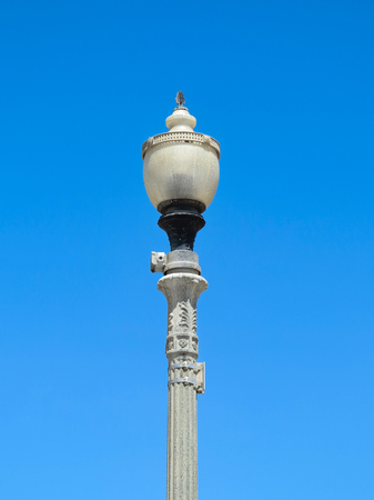 A tall lamp post with blue sky behind Stok Fotoğraf