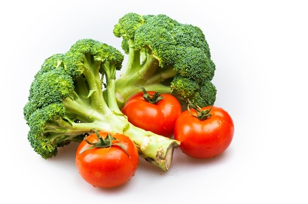 broccoli and tomatoes isolated on white background Archivio Fotografico