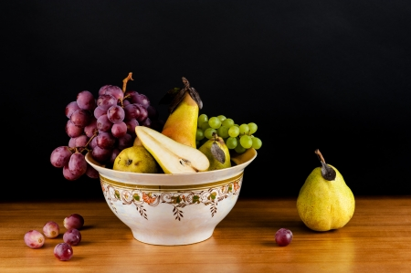 beautiful still life of ripe grapes and pears photo