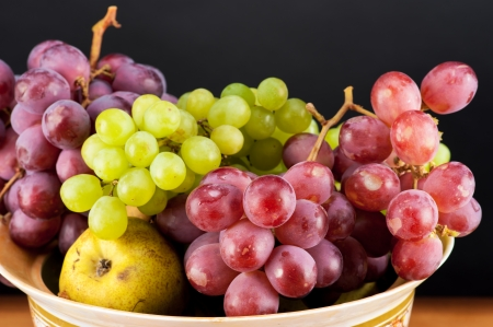 still life of ripe grapes and pears photo
