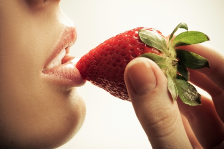 sensual mouth and strawberry photo