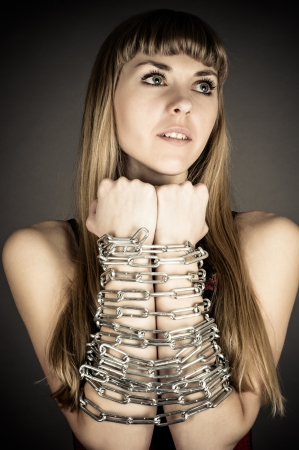 beautiful woman related with an chain photo