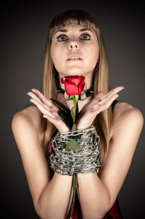 beautiful woman with a rose in hand photo