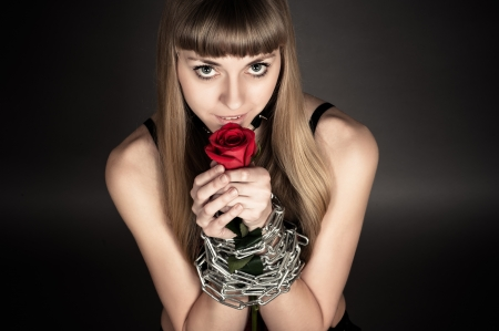 beautiful woman with a rose in his hand looks sexy