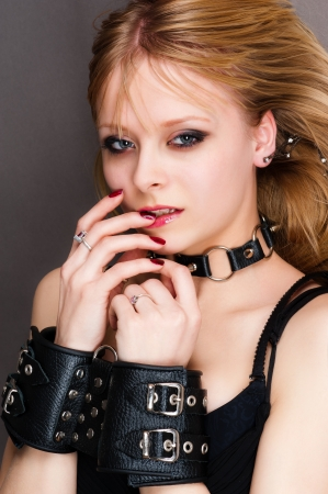 bondage girl: portrait of a passionate young woman in handcuffs