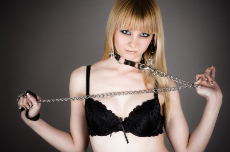 beautiful bangs: sexy woman in underwear with a leash in hand
