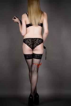 rear view of luxury woman standing in underwear full length photo