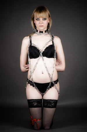 cute woman in lingerie chain tied around photo