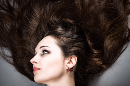 portrait of a beautiful brunette. Healthy Long Hair photo