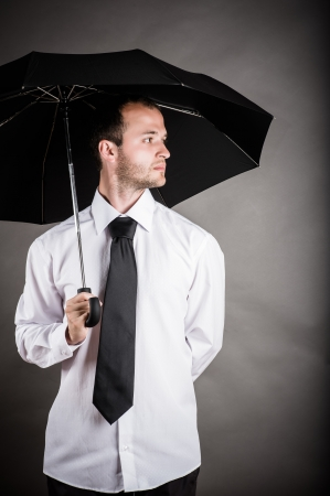 business man with an umbrella in hand photo