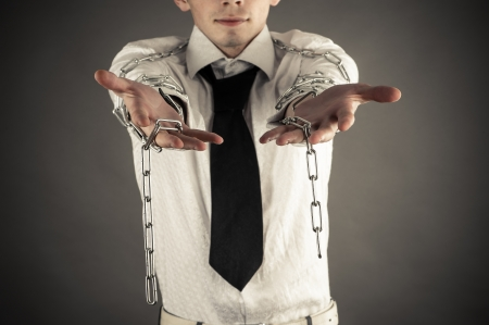 businessman showing hand with a broken chain photo