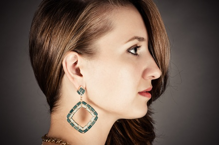 profile of beautiful woman with pierced ears photo