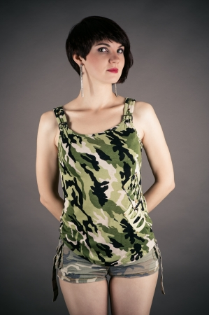 female sexuality: beautiful woman in military uniform Stock Photo