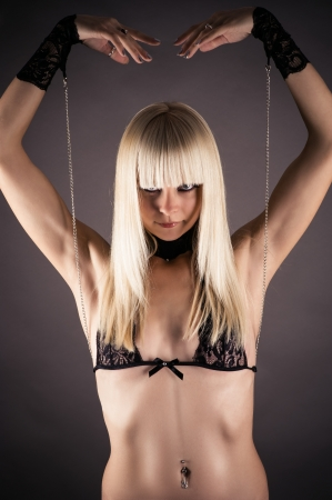 masochism: beautiful woman in lace cuffs as marionette Stock Photo