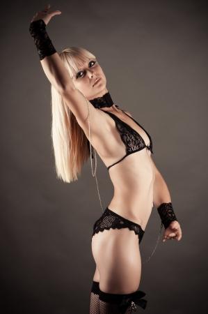 beautiful woman dancing in handcuffs