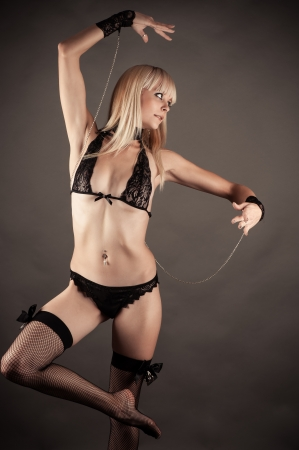 masochism: beautiful woman in the role of marionette dancing Stock Photo