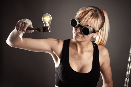 crazy creative woman looking at a light bulb photo