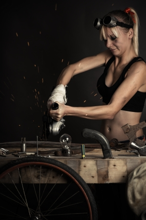 woman worker cuts metal grinder photo