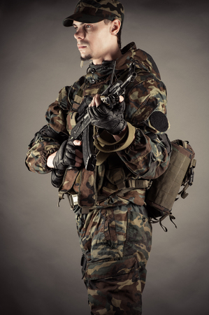 military man: military man with rifle weapon