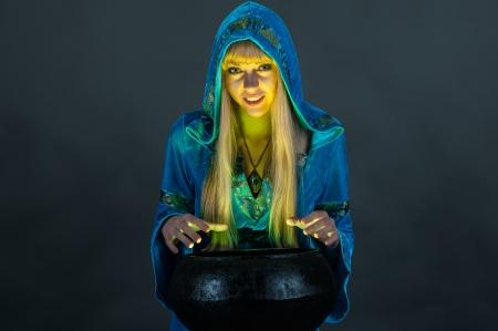 witch with cauldron Stock Photo