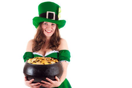 female leprechaun: woman dressed as a leprechaun with a pot of gold in hands Stock Photo