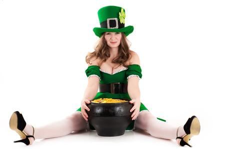 female leprechaun: woman dressed as a leprechaun sitting on the floor