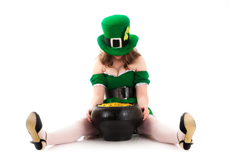 woman dressed as a leprechaun sitting on the floor photo