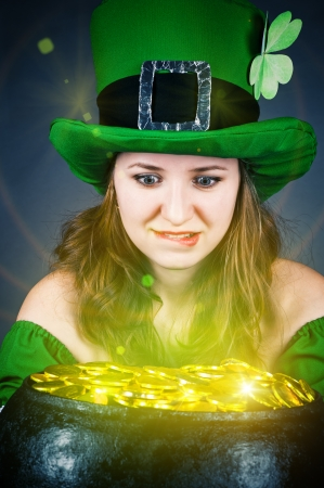 a woman dressed as a leprechaun with greedy eyes photo