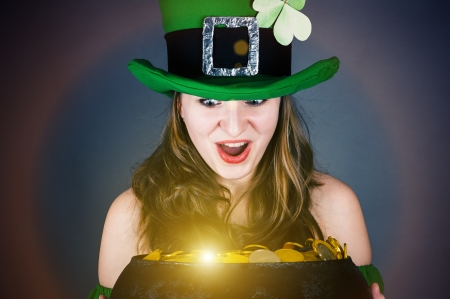 woman dressed as a leprechaun with surprise looks photo