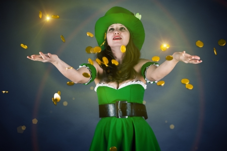 a woman dressed as a leprechaun gold coin throws up photo