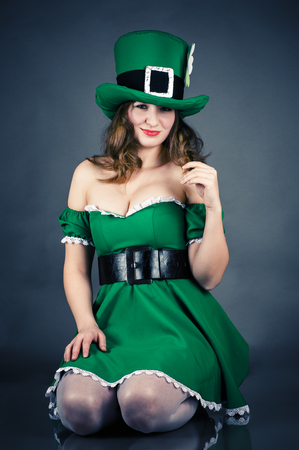 woman dressed as leprechaun isolated on gray background