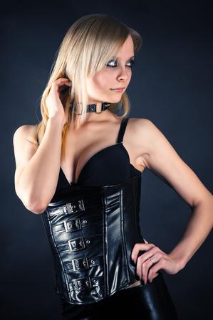 sadistic: beautiful seductive woman in a corset