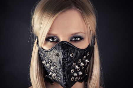 bondage girl: portrait of a woman in a mask with spikes