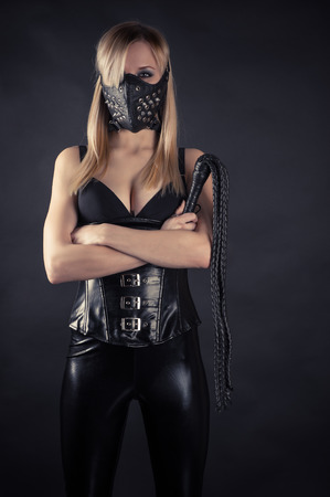 bondage girl: woman slave in a mask with spikes