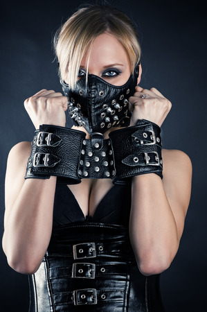 bondage woman: woman slave in a mask with spikes