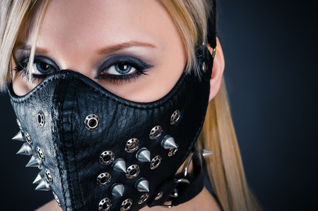 portrait of a woman slave in a mask with spikes photo