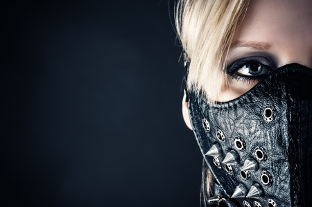 bdsm: portrait of a woman slave in a mask with spikes Stock Photo