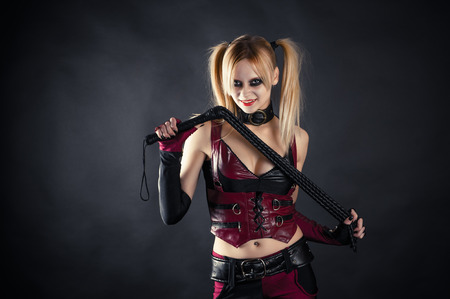woman with a whip in the image of a girlfriend joker