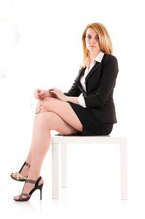 sexy secretary: mujer de negocios aislados sobre fondo blanco
