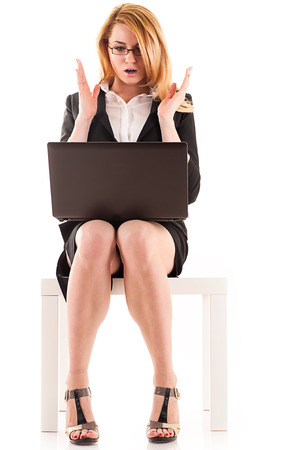 surprised business woman looking at laptop photo